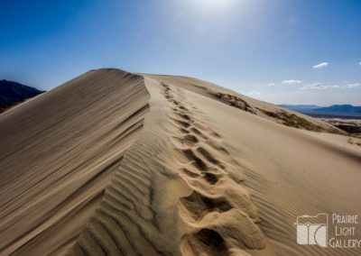Footprints at the top of Kelso Sand Dunes